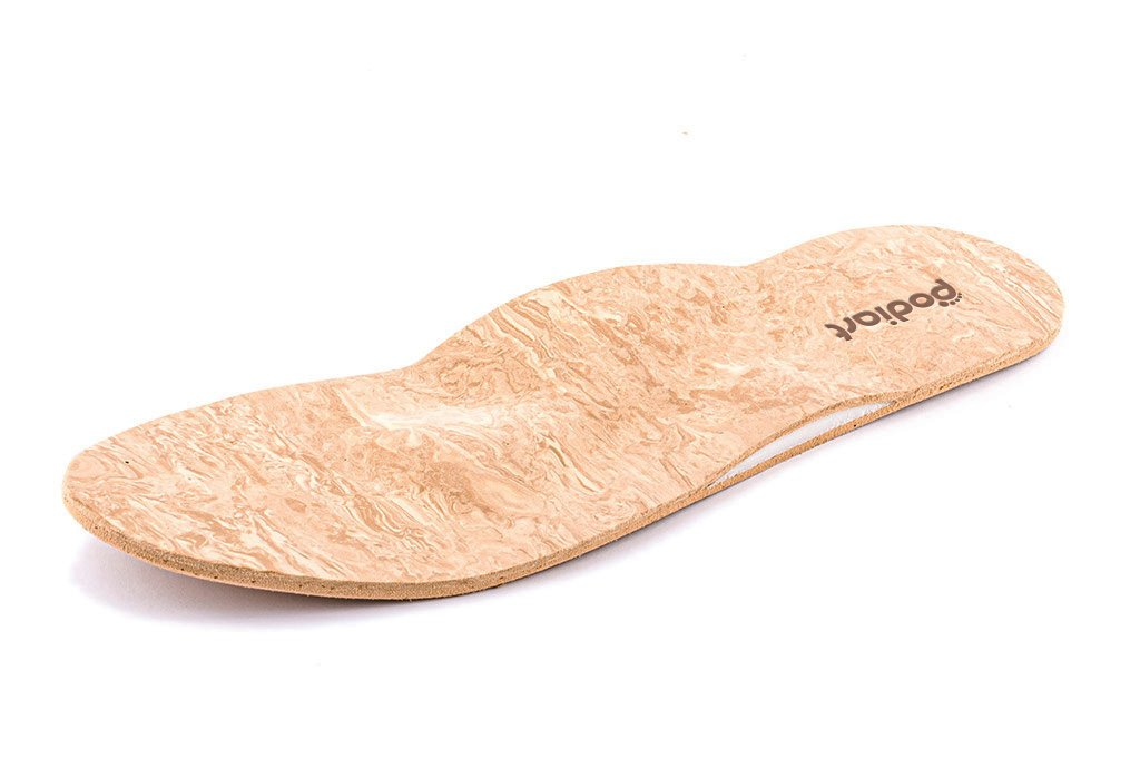 Leather based sole with a polyfoam top layer